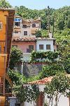 Agios Ioannis: Blick von der Prommenade den Ort hoch